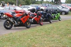 Motorcycles. Motorbikes. Bikes. Cycles. Car park Royalty Free Stock Photography