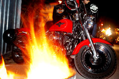 Motorcycles parked between barrels with fire Royalty Free Stock Photography