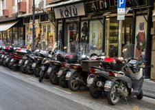 Motorcycles parked on a main shopping street in Sorrento, Italy. Pictured are motorcycles parked on a main shopping street in Sorrento, Italy.  The motorcycle is Stock Images
