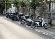 Motorcycles parked on a narrow street in Sorrento, Italy. Pictured are motorcycles parked on a narrow street in Sorrento, Italy.  The motorcycle is a popular Stock Photography