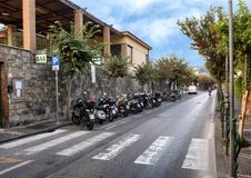 Motorcycles parked on a narrow street in Sorrento, Italy. Pictured are motorcycles parked on a narrow street in Sorrento, Italy.  The motorcycle is a popular Royalty Free Stock Image