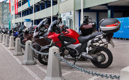 Motorcycles parked Stock Photos