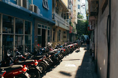 Motorcycles is parked at parking lot in the city of Male, the capital of the Maldives Royalty Free Stock Photos