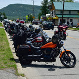 Motorcycles parked on street Royalty Free Stock Photography
