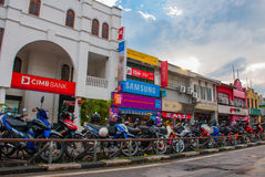 Motorcycles parked on the street near the road. Kuching. Sarawak. Borneo stock images