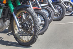 Motorcycles on parking on asphalt  close up Stock Photos