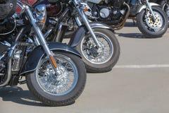 Motorcycles on parking on asphalt  closeup Stock Photos