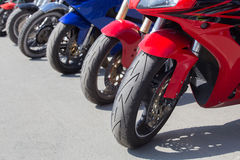 Motorcycles on parking on asphalt Stock Photos