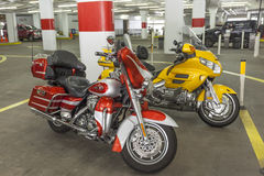 Motorcycles in a parking garage Royalty Free Stock Image