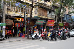 Motorcycles parking at traffic light in Hanoi old quarter, Vietnam. Stock Photography