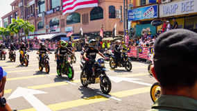 Motorcycles. Public peoples watching a convoy of motorcycles club at Malaysia national independance day Royalty Free Stock Images