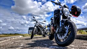 Motorcycles on road royalty free stock photography