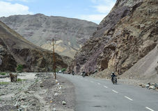Motorcycles run on mountain road in Ladakh, India Royalty Free Stock Images