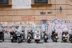 Motorcycles and scooters parked in the street. Palermo, Italy - April 11, 2016: motorcycles and scooters parked in the street Royalty Free Stock Image