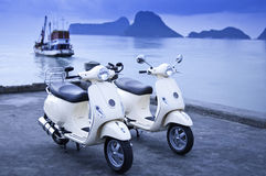 Motorcycles by the Sea. Two old style motorcycle by the sea Royalty Free Stock Image