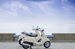 Motorcycles by the Sea. Two old style motorcycle by the sea Royalty Free Stock Photo