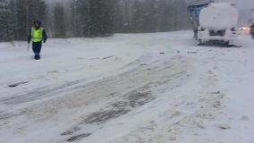 Motorcycles with sidecars are standing on the sidelines of winter road. The accident involving trucks. Motorcycles with sidecars are standing on the sidelines of stock video footage