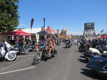 Motorcycles on the street at the Sturgis, SD, motorcycle rally. Riders, pedestrians and motorcycles on the street during the Sturgis, South Dakota 77th Annual Royalty Free Stock Image