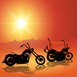 Motorcycles at sunset Stock Images