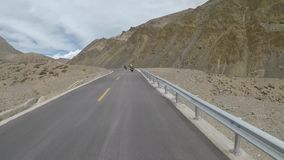 Motorcycling at altitude Tibet stock video footage