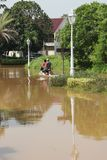 Motorcycling through the flood Stock Images