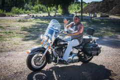 Motorcycling in USA. A motorcyclist riding his Harley Davidson leaves his campground on his way to doing more touring in USA Stock Images