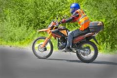 Motorcyclist biker fast riding Stock Photography