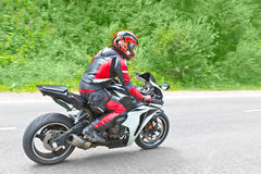Motorcyclist biker fast riding Stock Photo