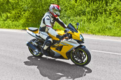 Motorcyclist biker fast riding Royalty Free Stock Image