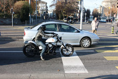 Motorcyclist biker stopped at an intersection. Zurich, Switzerland - November 27, 2011. Motorcyclist biker stopped at an intersection Royalty Free Stock Photography