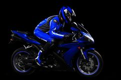Motorcyclist in blue equipment Stock Photos