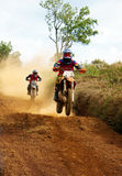 Motorcyclist on the competition at motorcycle race. The motorcycle race hole on December at Dambri waterfall, motorcyclist try to speed up goal, red soil way stock photos