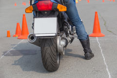Motorcyclist on competition start Royalty Free Stock Photo