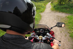 Motorcyclist on country road, shoulder view Royalty Free Stock Photos
