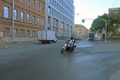 Motorcyclist crossing the intersection at speed stock image
