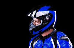 Motorcyclist in dark blue equipment Stock Photo