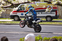 Motorcyclist doing an wheelie Stock Photo