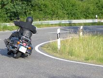 Motorcyclist drives through a bend royalty free stock photography