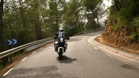 Motorcyclist Driving his Sports Motorbike on a Curvy Road stock video footage