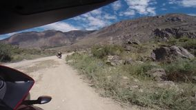 Motorcyclist driving on mountains stock video