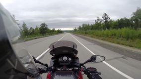 Motorcyclist driving on road stock video