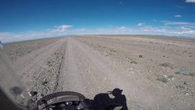 Motorcyclist driving on steppe stock video footage