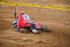 The motorcyclist fell. MOSCOW, RUSSIA - SEPTEMBER 10, 2016: Crystalev Fedor 16 Free Riders Group, Vidnoe, class `Country Kidz`, in the 4 stage of the XSR-MOTO.RU royalty free stock image