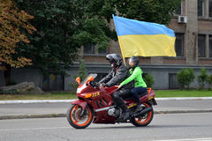 Motorcyclist with flag of Ukraine Stock Image