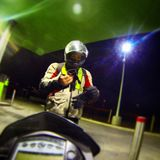 Motorcyclist in a gasstations Stock Images
