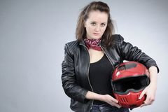 Motorcyclist girl posing Royalty Free Stock Photography