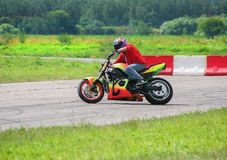 Motorcyclist goes on motorcycle Royalty Free Stock Images