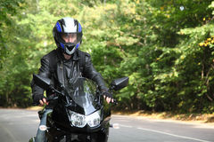Motorcyclist goes on road royalty free stock images
