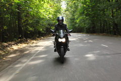 Motorcyclist goes on road, front view Stock Image
