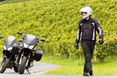 Motorcyclist having a break Royalty Free Stock Photos